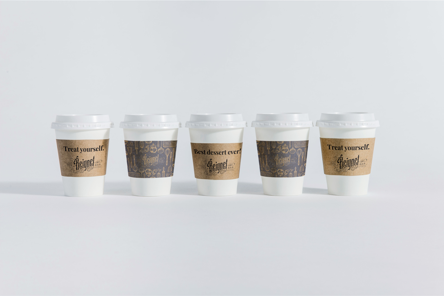 The Beignet Bar Packaging Coffee Sleeve designed by Hire Henri Creative in Chicago Illinois